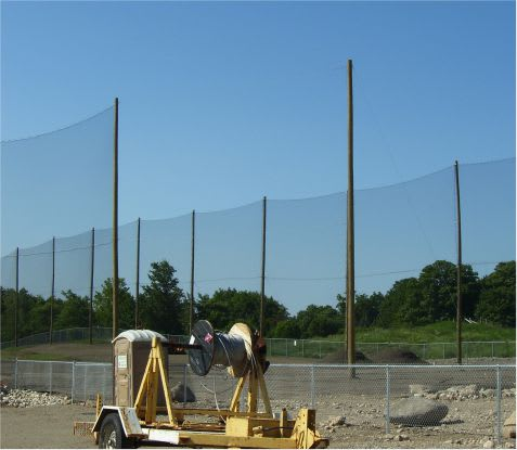 guy wire feeder - netting installation golf course