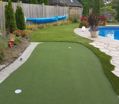 backyard turf poolside with putting green