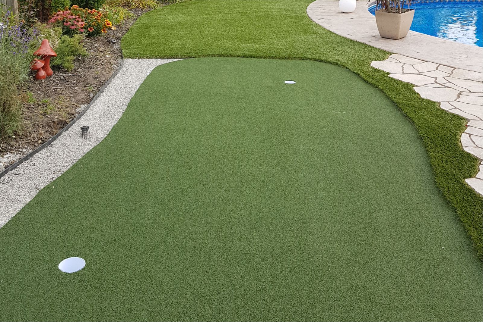 landscape turf with putting green in backyard
